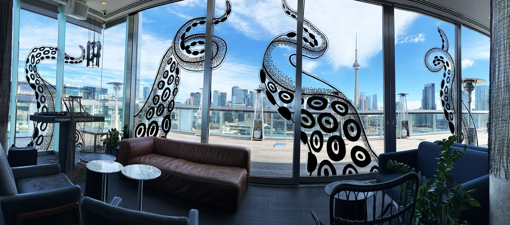 window mural art, thompson toronto hotel, rooftop patio