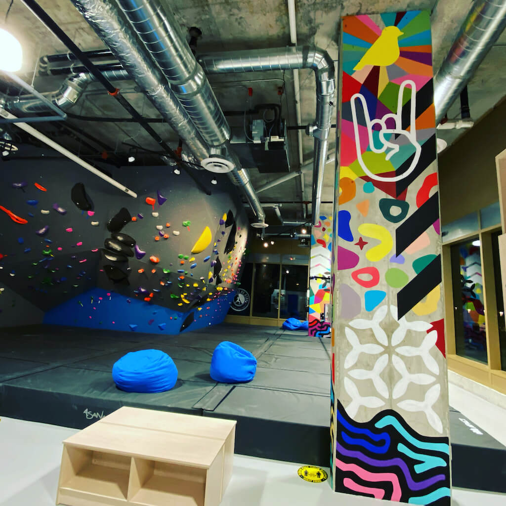 hand-painted 18 feet tall concrete columns for a rock climbing gym